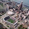 Cleveland with Progressive Field and Quiken Loans Arena in the foreground with Cleveland Browns Stadium in the background.