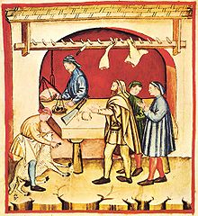 This picture is showing a 14th century butcher doing his trade in a traditional manner.