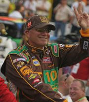 photo of NASCAR driver Dale Jarrett waves to crowd