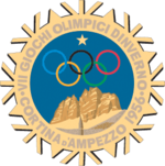 "A stylized snowflake with the Olympic rings, a star and mountains. Surrounding the perimeter of the snow flake are the words, ""VII Giochi Olimpici Dinverno, Cortina d&squot;Ampezzo 1956"""