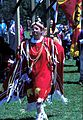 """Woman in red ceremonial dress dancing at 2000 Pow-wow at Eel Ground First Nation"""
