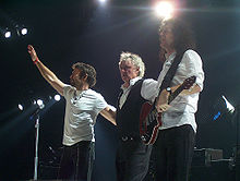 l-r:Paul Rodgers, Roger Taylor, and Brian May live in 2005 for the Queen + Paul Rodgers tour.