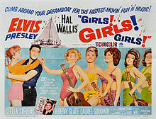 """Movie poster with Presley on the left, holding a young woman around the waist, her arms draped over his shoulders. To the right, five young women wearing bathing suits and holding guitars stand in a row. The one in front taps Presley on the shoulder. Along with title and credits is the tagline """"Climb aboard your dreamboat for the fastest-movin&squot; fun &squot;n&squot; music!"""""""