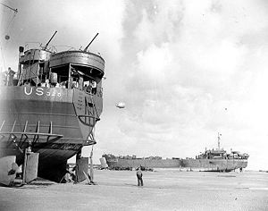 LST-325 (left) and USS LST-388 unloading