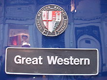 """A black nameplate stating """"Great Western"""" with a multi-coloured shield above."""