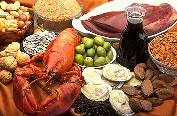 Image illustrating rich and good nutritional sources of copper including: oysters, beef or lamb liver, Brazil nuts, blackstrap molasses, cocoa, and black pepper, lobster, nuts and sunflower seeds, green olives, and wheat bran.