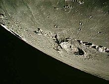 grayscale image of a crater on the moon