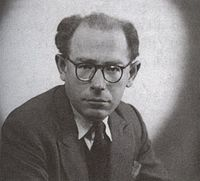 Man with large-rimmed spectacles