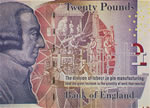 A bank note depicting a man's head facing to the right