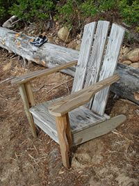 A weathered Adirondack chair