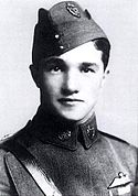 Head-and-shoulders portrait of young dark-haired man in military uniform wearing forage cap