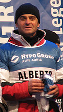 Alberto Tomba in hat and ski clothes