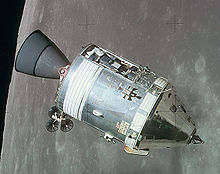 Image of the Apollo Service Module with the moon in the background