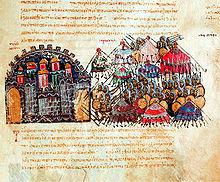Photographie présentant une page de texte arabe rédigé en rouge, comportant une miniature très colorée représentant le siège de la ville.