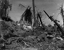Soldiers of the U.S. 7th Infantry Division attack a Japanese blockhouse on Kwajalein