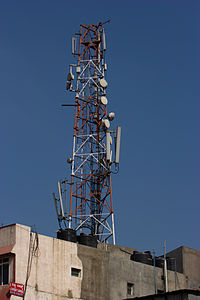 Cellular phone tower atop the roof of a building