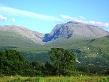A view of Ben Nevis in the distance, fronted by rolling plains