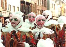 Binche, «Gilles portant leur masque de cire»