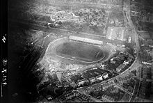 B&W photo of the stadium from the air