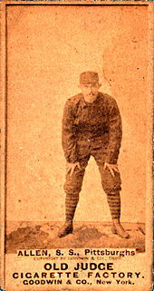 Sepia-tone baseball card of Bob Allen bent over, by the Old Judge Cigarette Factory