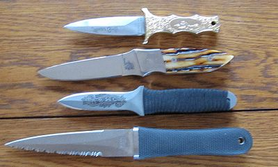 caption=Four boot knives, including a SOG Pentagon, custom stag handled boot knife, Ek knife and Parker Bros knife