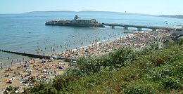 photograph of a crowded Bournemouth beach in summer