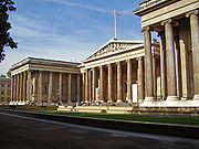 A museum building designed in the Greek Revival style with a flag on top.