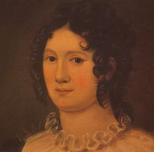 Portrait d'une femme montrant son cou et sa tête. Sa chevelure brune a de petites mèches bouclées («anglaises»), et on peut voir le jabot plissé qui orne le devant de sa robe. La peinture est dans des tons oranges et bruns.