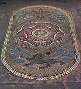 A cobblestone mosaic showing heraldic devices associated with the House of Lancaster