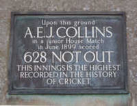 """A plaque that reads: """"Upon this ground // A. E. J. COLLINS // in a junior House Match // in June 1899 scored // 628 NOT OUT // THIS INNINGS IS THE HIGHEST // RECORDED IN THE HISTORY // OF CRICKET"""""""