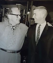 Two men in a black and white photo.