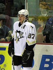 Photographie de Sidney Crosby portant le numéro 87 des Penguins.