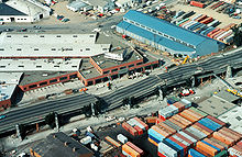 Image of collapsed double-decker freeway structure in Oakland, California