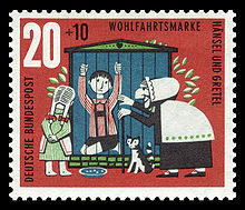 Postage stamp showing Hansel imprisoned in a cage with the evil stepmother and Gretal standing outside.