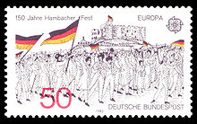 Black and white image of the demonstrators at the Hambach festival, carrying flags, depicted on a postage stamp: in the upper left corner, the words 150 Years Hambach Festival commemorate the festival; in the lower right, are the words German postal service.