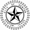 "A 3D black and white star. The words ""City of Denton Denton, Texas"" encircle the star."