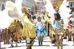 una comparsa de baile liderada por el Arcángel San Miguel.