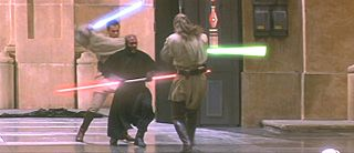 Three men in robes fight with laser swords in a hangar.