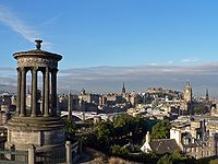 View of Edinburgh from Calton Hill. The Dugald Stewart memorial is visible in the foreground.