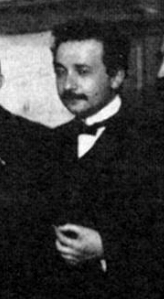 Upper body shot of man in suit, high white collar and bow tie.
