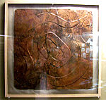 Ogee motif-repousse copper plate from the Etowah Site