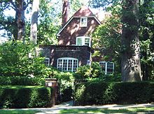 Larger, two-story house in leafy setting