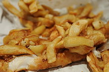 Fish and chips wrapped in paper.