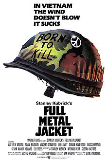 "Against a white backdrop is a camouflaged military helmet with ""Born to Kill"" written on it, a peace sign attached to it, and a row of bullets lined up inside the helmet strap. Above the helmet are the words, ""In Vietnam the wind doesn&squot;t blow it sucks."""