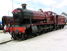 "The red locomotive train used as the ""Hogwarts Express"" in the film series. In the front it has the numbers ""5912"" inscripted on it."