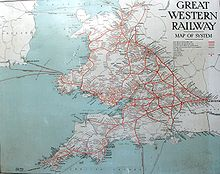 """A map showing Wales and south west England. The words Great Restern Railway"""" are at top left, the sea is pale blue and railway lines red, many of which seem to radiate from London on the right"""