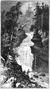 A black and white artisitic work of a large waterfall dropping over a rocky cliff on a forested mountain. The falls are surrounded by large conifer trees and a fisherman is in the foreground.