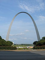 The arch rises from the bottom left of the picture and is shown against a featureless clear sky