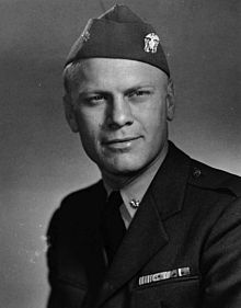 The head and shoulders of a man in a World War Two-era uniform of the United States Navy.