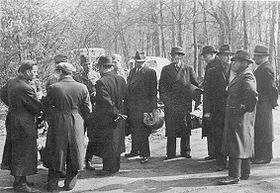 Gestapomen following the white buses.jpg
